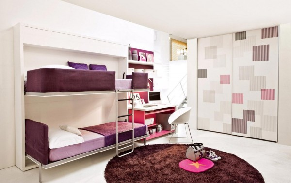 This purple kid's room, for instance, is relatively small but still has room for two beds because they can both fold up into the wall.