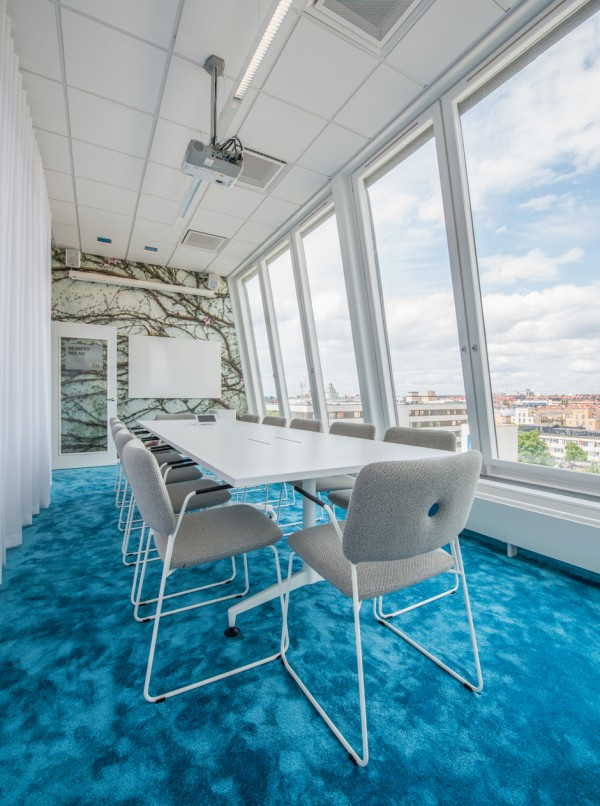 Meeting areas are a must for any office. The renovations have provided plenty of space, but it is the modern furnishings such as padded wire chairs and a brilliant turquoise carpet that make them stand out from your typical concrete box.