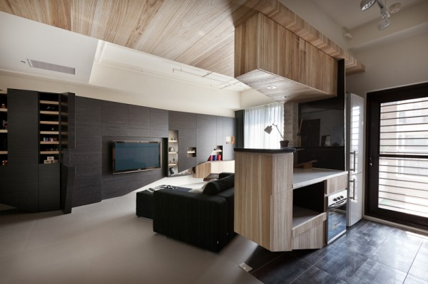 This apartment shows us the flipside of monochromatic design, focusing instead on darker design with black, slate, and dark grays in much of the apartment.