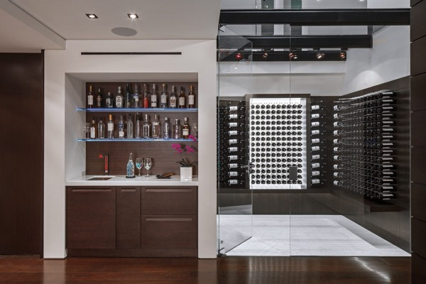 Careful combinations have resulted in a masterpiece that holds beautiful transitional spaces that include a wine cellar and wet-bar that can be seen through glass floors, enticing you just a few meters from the main floor foyer.