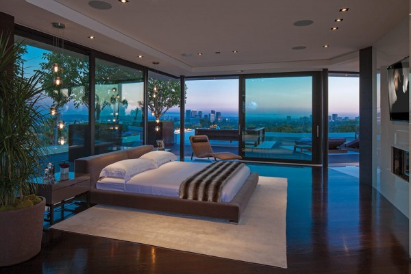 The master bedroom covers the entire third floor, allowing plenty of space for his and hers closets, a huge glass fireplace, spa bathroom, and its own outdoor deck.
