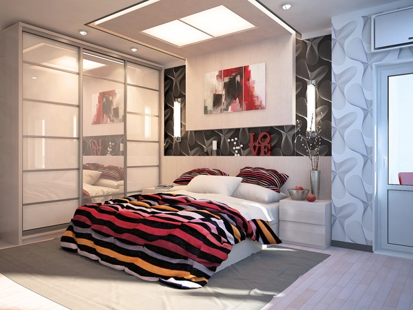This bedroom really shakes up it's monochrome walls by introducing a multicolored bedspread and pillowcases–a great idea that anyone can utilize in their black, white or gray room.