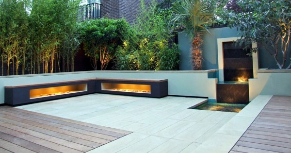 This built-in waterfall will create soothing sounds, whilst the glow from the lighting effects evokes a feeling of warmth whilst outdoors. Benches around the perimeter provide seating for contemplation.