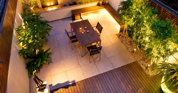 This roof patio provides a perfect platform for al fresco dining with guests. A piece of sculpture brings a touch of sophistication to the look.