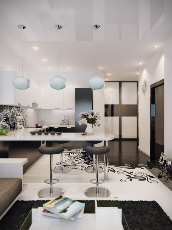 For a couple or roommates, a stylish breakfast bar can easily take the place of a full on dining room. These padded stools and sleek white countertop is clean and comfortable without taking up too much precious space in this monochromatic apartment.