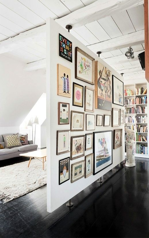 Installing an entire wall is not always an option. This large panel only affixes in a few places, making installation and removal easy. As you can see, it also gives a perfect place to display art.