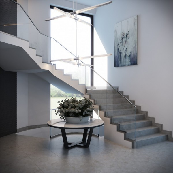 An elegant entryway can set the tone for a whole home. This sweeping staircase with a modern glass rail is simple but edgy.