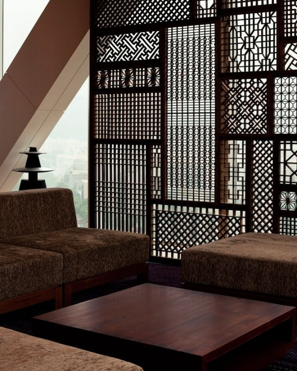 Of course, there are also those times that intricacy wins out over simplicity, like in the delicately carved wood partition.