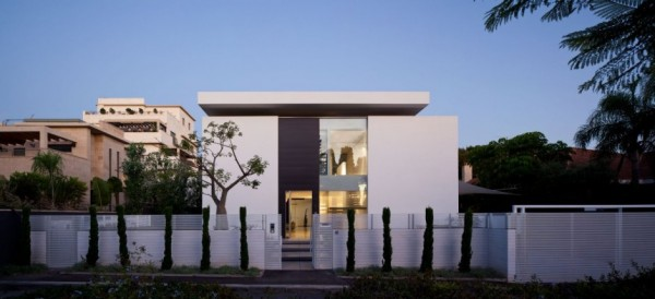 The front of the home is purposefully anonymous, barely betraying the sweeping modern designs inside.