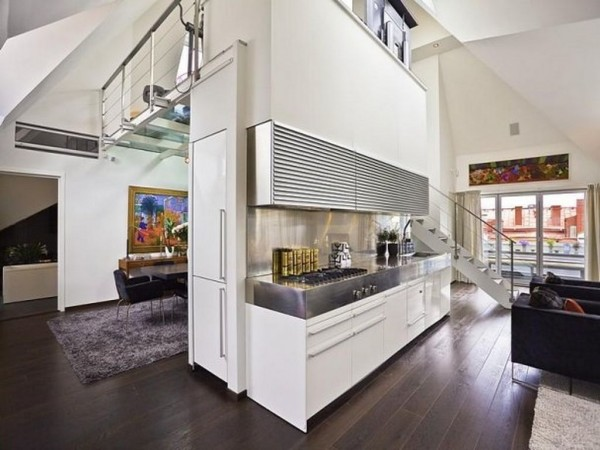 In this urban space, the kitchen itself acts as a central divider.