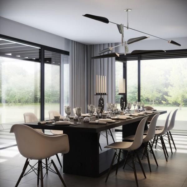 These simple white dining chairs could easily adorn a classroom. Marrying the highminded style of candelabras with the accessible simplicity of the chairs adds interest to this contemporary dining room.