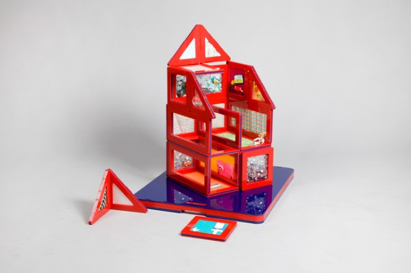 """mae-mak house"" by Mae in associate with MAKLab and Burro Happold is a truly interactive experience with many flat pieces creating a full dollhouse and then folding down into a flat carrying case."