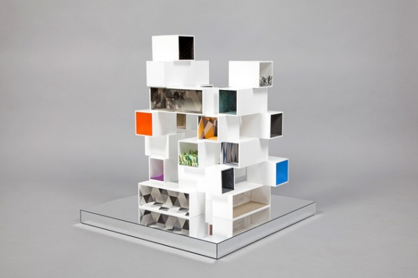 """Haptic House"" by Dexter Moren uses stacked boxes to create a plethora of tiny rooms in this unique dollhouse design."