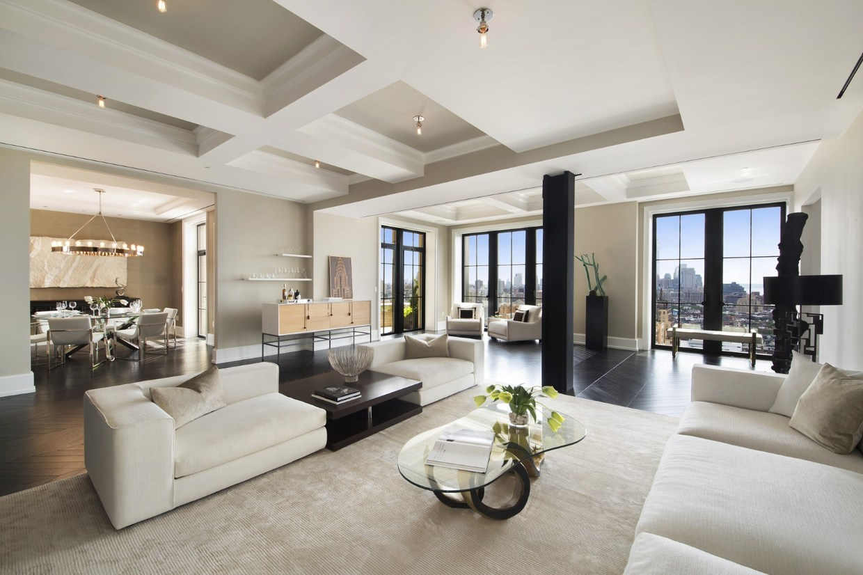 This gorgeous 4,871 square foot apartment occupies a duplex space atop Walker Tower. The modern interior respects the traditional architectural details, incorporating many of the Art Deco details original to the 1930s tower. The interior staging offers a nod to the building's history as well: metallic accents and blocky geometric patterns are abundant throughout, and contrasting black and white themes seamlessly alternate with calm natural palettes.