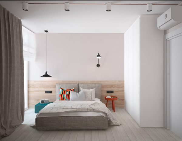 A minimalist bedroom offers a respite from the art deco theme, while subtly referring back to it. Muted teak floors with burnt orange and teak fixtures mark either side of the master bed, while boxed shelves in the same colour offer storage and a point of difference.